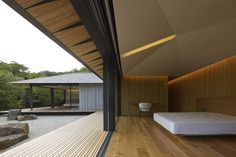 The PC House byrenownedjapanese architectKengo Kumaisa private single-storey house in eastern japan.With a strong roots in traditional japanese temples the program is arranged in a windmill formation with four distinct and independent rooms originating from the center-point of the design.
