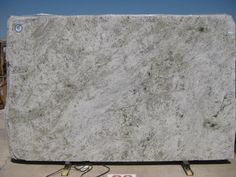 Salinas White granite countertop. A great alternative to hard-to-maintain marble but with the sturdiness of granite.