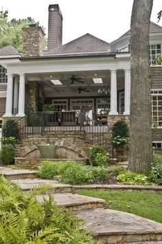 The walk, stone, porch with columns and fans.  Love it allusive the stone Live stove, fans lights etc