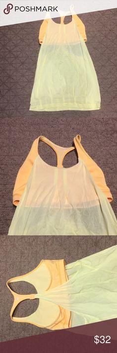 Lululemon yellow tank top with built-in bra Yellow tank top with built-in bra. Brand new, NEVER worn! lululemon athletica Tops Tank Tops