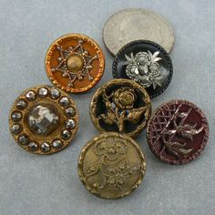 Victorian era small, intricate antique metal buttons.