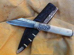 Saxon seax by Gullinbursti (http://www.gullinbursti.cz/). Note the carved bone handle and the silver inlay on the blade spine.