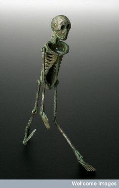 """An ancient Roman larva convivialis, a memento mori. 'Memento mori translates from Latin as """"Remember you must die"""". This is a special type of memento mori called a larva convivialis, given to revellers at a banquet or feast. Even when the Romans were enjoying themselves, they still were reminded of their own mortality. The bronze skeleton is just over 110 mm high. (Science Museum, London/Wellcome Images via Nezka Pfeifer)"""