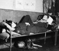 American volunteers, Flight Sergeant Bill Kelly (left) and Flying Officer Osbourne of No. 121 (Eagle) Squadron, RAF, at rest in the Dispersal Hut at Rochford airfield in Essex during 1942.