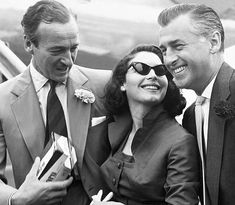 Niven, left, with Ava Gardner and Stewart Granger on their way to Rome to film The Little Hut in 1956