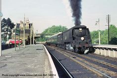 Bulleid's 'Battle of Britain' class No 34080 74 Squadron at Sherborne station with a train for Exeter on 10th May 1964