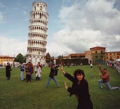 Classic Tourist Shot: How funny is this?  They are ALL holding up the tower--what would we do without their help??