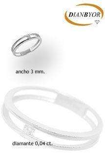 Solitario de oro blanco de 18 kilates de la firma Dianbyor. Ancho de 3 mm. Anillo de oro blanco con diamante tallado en talla brillante. Perfecto como anillo de pedida o compromiso.