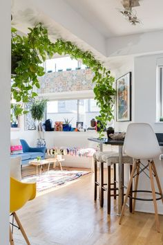 This sunny, plant-filled Manhattan loft is full of funky vintage finds. This place is filled with so much sunlight, green plants, and gorgeous views it's going to make you want jungle vibes in your own home. Bedroom Loft, One Bedroom, Bedroom Apartment, Apartment Plants, York Apartment, Bedroom Ideas, Bedroom Decor, Orange Living Room Sofas, House Plants Decor