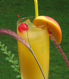 Peach Pirate  (2 oz. Captain Morgan's Spiced Rum  2 oz. Peach Schnapps  4 oz. Orange Juice  Slice of fresh Peach and Cherry for garnish)