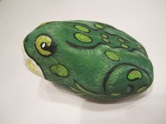 Hand painted rock (frog).  One of many rocks collected in my travels.  Perfect garden addition 2013 ~ By Robin Rivera