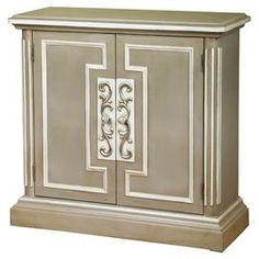 """Display a vase of fresh blooms in your foyer or stow table linens in the dining room with this grey and beige cabinet, showcasing front molding and 2 doors opening to 1 adjustable interior shelf.   Product: Chest Construction Material: Wood Color: Grey and beige  Features:    Two doors  One adjustable shelf behind doors Hand-painted Dimensions:  36"""" H x 34"""" W x 14"""" D"""