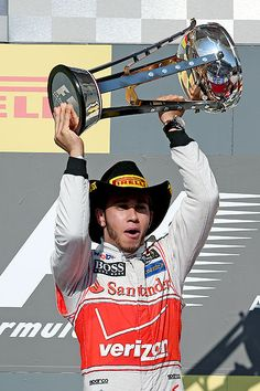 Lewis Hamilton celebrates with the trophy after winning the first U.S. Grand Prix held at Austin's Circuit of the Americas.