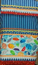 stripes blue rida with umbrella panel. smart wear for young girls. available. contact zainab.sura@gmail.com