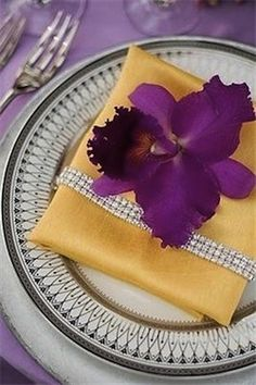 real flowers on the napkins. different way to decorate? contrast of colors could be nice. would want a brighter yellow. purple is nice