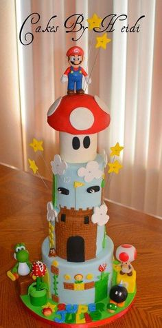 """4 tiered super mario cake.. sized included 4"""", 6"""", 8"""" & 10"""" Cake Layers and Fillings: Vanilla and chocolate sponge filled with Bavarian Cream, Red Velvet cake with a cheese cake filling, Chocolate cake filled with chocolate mousse and Six..."""