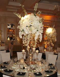 Reception Décor: White Centerpieces | InsideWeddings.com