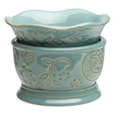 Whimsical debossed paisley prints swirl over Carrey's cornflower backdrop, topped with a scalloped warmer dish.   https://aromamia.scentsy.us/Scentsy/Buy/ProductDetails/23234?categoryId=1152