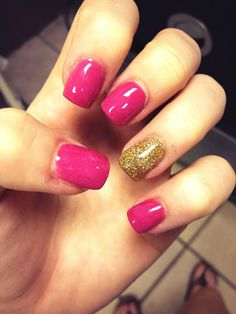 Pink and gold glitter gel acrylic nails