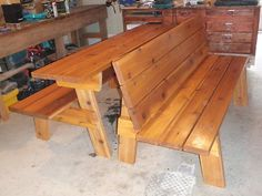 Might have to have the future husband make 1 or 2 of these for around our fire pit. Picnic table that converts into 2 benches.