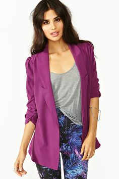 Oversized violet blazer featuring ruched sleeves and a sheer chiffon back. Open front, unlined. Looks super cute tossed over a graphic tank and cutoffs!