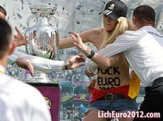 The infamous clothing-optional protest group FEMEN has attacked the Henri Delaunay Trophy, commonly known as the Euro Cup, which is awarded to the winner of the European Football Championship. As always, the girls were defiantly topless. Euro 2012, European Football, Sports, International Soccer, Hs Sports, European Soccer, Sport