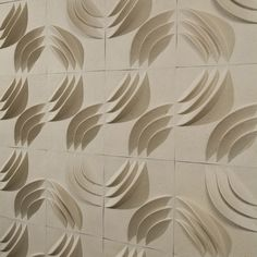 3 D wall tiles shown as is, come in sets of 12, made of paper.