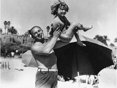 SHIRLEY TEMPLE with her father George at the Santa Monica Athletic Club in Santa Monica on June 5, 1934.