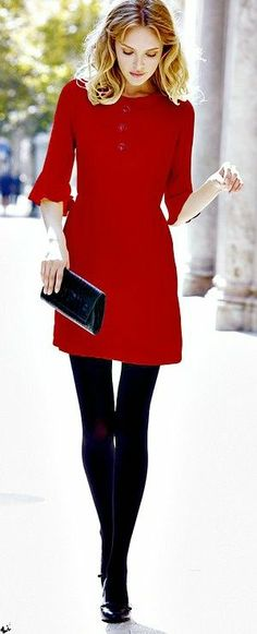 Red with black tights. Nice cut and color. Would like it to be just above the knee, for me.
