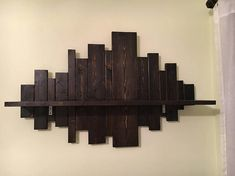 This reclaimed wood pallet wall shelf is the perfect display piece for your home! Fill that empty wall space with this 100% customizeable reclaimed wooden plank shelf. Make it the focal point of your living room, dining room, bedroom or even bathroom. Perfect for displaying small