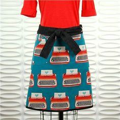 a versatile skirt from lark designs - love the typewriters with heart paper!!  comfortable, easy to wear and stylish to boot! elegant enough to wear to work, but works great for wading through the chores and challenges of your every-day. Makes the perfect getaway-weekend skirt:  all you need is this skirt, a couple of t-shirts and a pair of sandals or flip flops. you're ready to go!