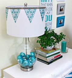 I know, I know...it's August, and I'm about to drop some Christmas on you...what in the world is going on? I am participating in a super fun challenge with some of my favorite blogging buddies, showing you a lamp makeover! Lamps Plus and Hometalk challenged us to take the beautiful Fillable Clear Glass Ovo Table Lamp and dress it up for the holiday season...I can't resist a challenge, so I jumped at the chance!