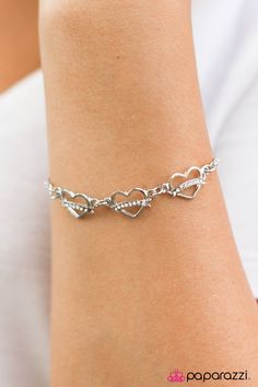 Perfect Valentine's Day Accessories!!! <3 Will You Be Mine? - White Bracelet. Three airy silver hearts infused with a ribbon of charming white rhinestones join a delicate silver chain for a dainty display.