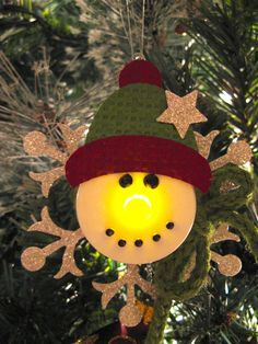 Snowman ornament made with a battery operated tea light, so cute! Snowman ornament made with a battery operated tea light, so cute! Christmas Ornaments To Make, Christmas Tea, Christmas Candles, How To Make Ornaments, Christmas Projects, Holiday Crafts, Christmas Holidays, Snowman Ornaments, Snowmen
