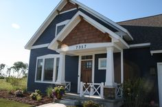 """Beach House Craftsman-style porch Hardie Board painted Sherwin Williams """"Naval"""""""