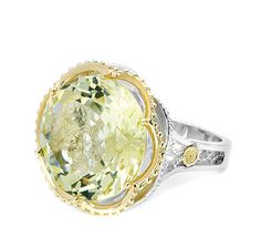 Lemon Quartz makes this ring fresh and flirty, with luscious round shape surrounded by rich 18k yellow gold. A slender, sculputural frame in .925 silver makes this sunny ring absolutely sensational.