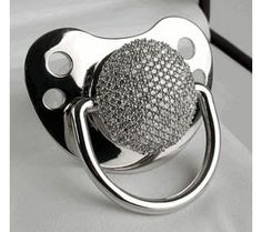 The Diamond Pacifier Keepsake Diamond Pacifier Product Description The diamond pacifier is exactly what everyone in Hollywood talks about. This exclusive diamond pacifier is the newest trend in celebrity baby gifting. This Sparkly Diamond Pacifiers Baby Bling, Bling Bling, Blue Ivy, Rocker, Baby Steps, Most Expensive, Expensive Taste, Brad Pitt, Angelina Jolie