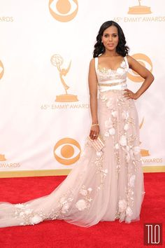 """Scandal"" star Kerry Washington attends the 2013 Primetime Emmy Awards held at Nokia Theatre L.A. Live in Los Angeles, California in a Marchesa dress paired with an Edie Parker clutch, a Movado watch, and Fred Leighton jewelry."