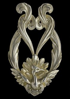 ART NOUVEAU, Lyre Bird Buckle, Gilded silver. H: 9.6 cm (3.78 in); W: 5.6 cm (2.2 in). Marks: Indistinct makers mark. French, c.1900. Literature: cf. The Paris Salons 1895-1914, Jewellery  Volume II: The Designers L-Z, Alastair Duncan, 1994, p. 112, for Lyre Bird buckle by Mellerio 1901-2  (Ref: 3427)