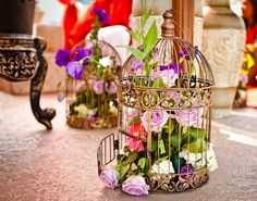 Flowers in a Bird Cage. Centerpiece Idea! http://www.melroseintl.com/searchadv.aspx?SearchTerm=bird+cage