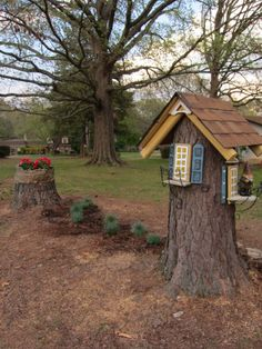 This is my Gnome House built from a pine tree stump. It is about 5 feet high. The little Gnome couple is from Hobby Lobby. Fairy Tree Houses, Fairy Garden Houses, Gnome Garden, Fairy Gardens, Tree Stump Decor, Tree Stumps, Fairy Garden Furniture, Fairy Doors, House Built