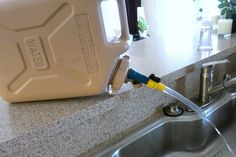 simple spout with shutoff for Scepter military water cans - Offroad Passport Community Forum