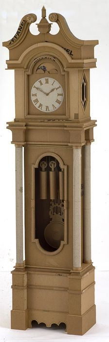 This is a grandfather clock sculpture made of corrugated cardboard, by Chris Gilmour. Cardboard Cartons, Cardboard Paper, Cardboard Crafts, Paper Crafts, Cardboard Design, Cardboard Boxes, Cardboard Sculpture, Cardboard Furniture, Grandfather Clock