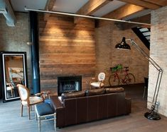 cool idea for a fireplace treatment, especially since the walls are brick