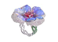 Katherine Jetter's ring is made in 18-karat white gold with hand-carved opal flower petals and diamond and tsavorite pavé ($24,000).