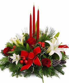 Decorate your Christmas table with a magnificent centerpiece featuring lilies, roses, and holiday greens!
