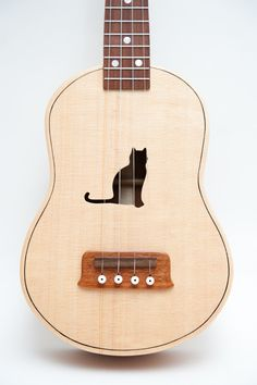 Ukulele (customizable sound hole of choice) Example: Cat by celentanowoodworks on Etsy https://www.etsy.com/listing/91113704/ukulele-customizable-sound-hole-of