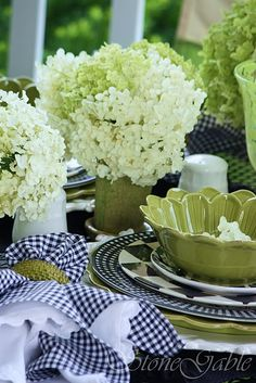 fresh and pretty - LOVE the COLORS, green & cream flowers with navy blue & white checkered linens, green or white dinnerware***