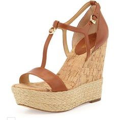 Women's Michael Kors brown wedges.size 7 Brand new Michael Kors brown wedges. Size 7 . Doesn't come with original box. Never even tried on. Michael Kors Shoes Wedges
