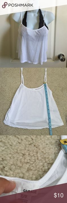 Garage White Flowy Crop Top THE BRALETTE IS NOT INCLUDED IN THE SALE ❕❕❕❕❗️❗️❗️❗️Very short crop top with adjustable straps. measurements are shown in picture (in centimeters). Perfect condition. It's slightly see through so that's why I suggest wearing it with a bralette! I've only worn this at most 4 times Garage Tops Crop Tops